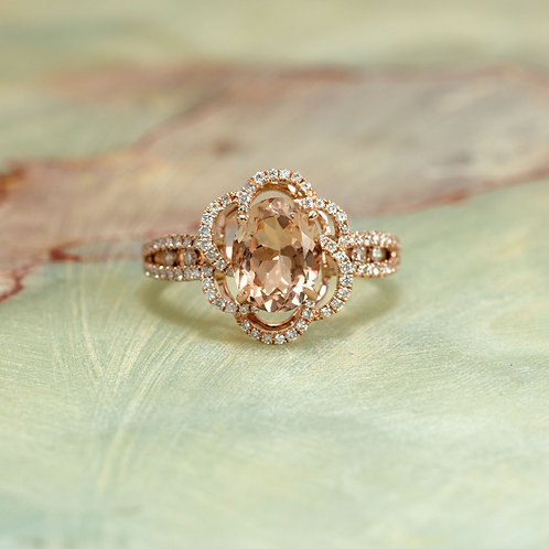 Rose Gold 14K Diamond Halo Engagement Ring Center Is A 9X7MM Oval Morganite