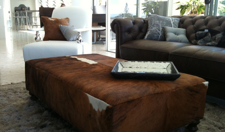 Recent project a rectangular ottoman in a cowhide