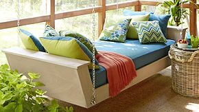 Outdoor day bed eith contrasting scatter cushions