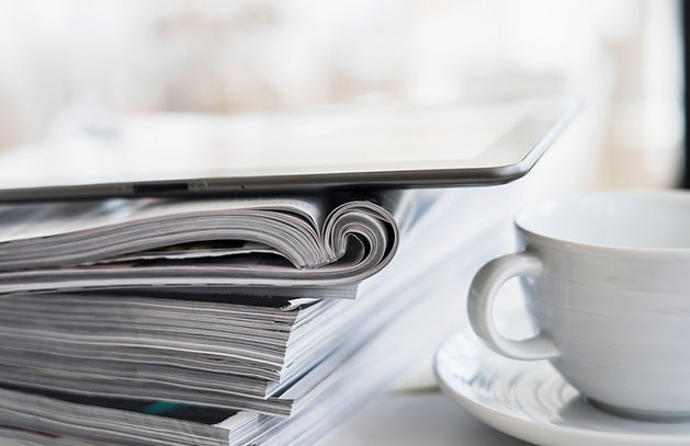 newspapers, magazines and tablet a