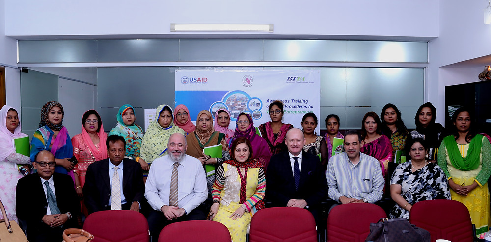 The BTFA team and the Dhaka Women's Chamber of Commerce and Industry sit down for a photo after a training session at the BTFA office.
