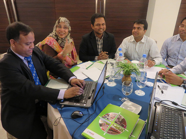 Mohammed Yussuf (left), one of the project's team members, works with Bangladeshi trade officials.