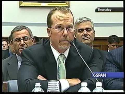 Mark McGuire testifies in front of a spacial committee.