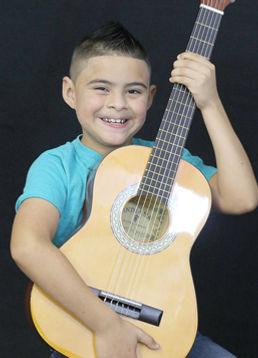 Kid with guitar.jpg