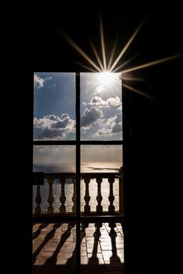 sun through the old window of Son Maroig