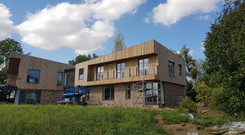 timber frame houise with virtical cedar cadding