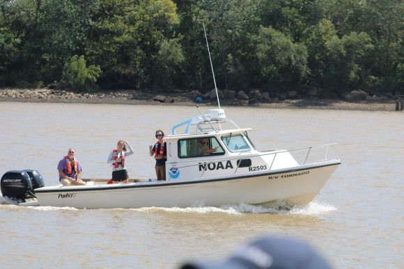 A research boat sails on the Delaware River