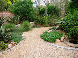 Gravel path edged with brick