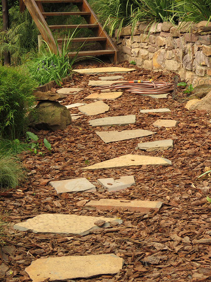 Stone and bark path surface
