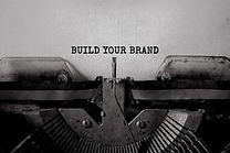 BUILD YOUR BRAND typed words on a vintag