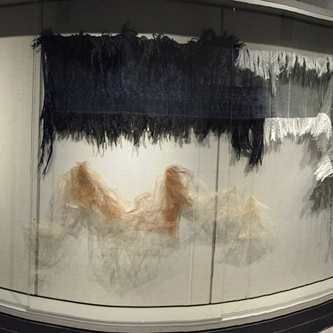 Weavings on display in SAIC's Advanced Fiber display case