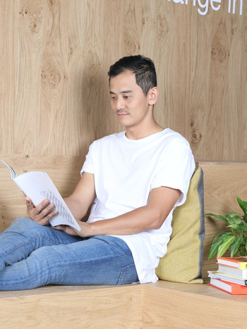 A Wix employee taking time to read at the office