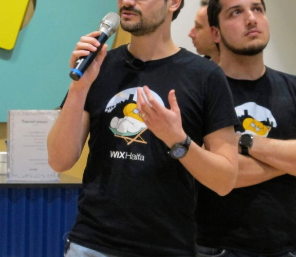 2 Wix employees wearing Wix Haifa t-shirts