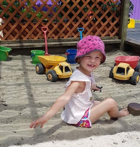 Girl in sandpit.jpg