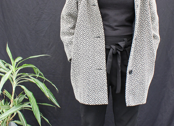 Manteau zigzag noir et blanc