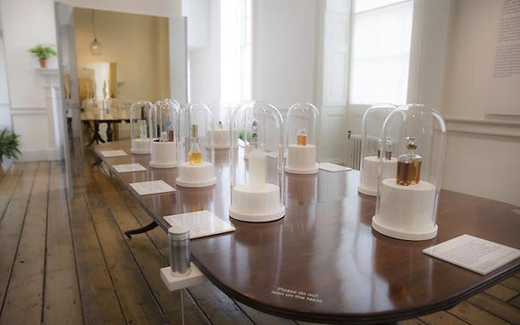 Exhibition display of perfume bottles at Somerset House London