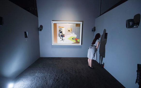 Woman smelling scent from a diffuser in art gallery