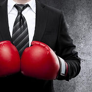 bigstock-Man-In-Boxing-Gloves-52758463-1