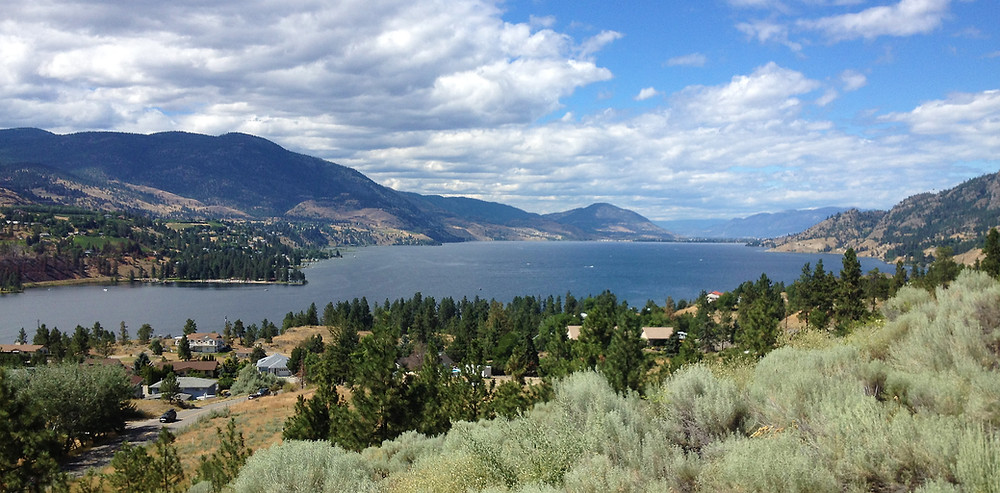 View to Penticton from the south at OK falls. Skaha Lake in the foreground. Penticton in the distance.