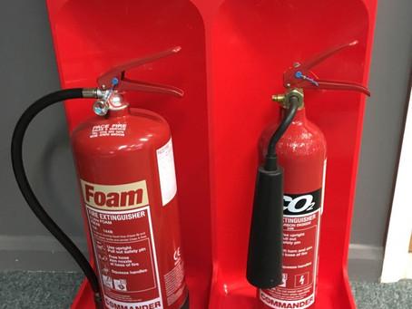 Fire extinguisher servicing. New extinguisher stands.