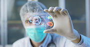 A physician, surgeon, examines a technol