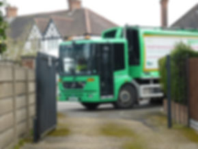 Refuse Vehicle Entering Service Road (Fo