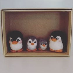 Family of needle felted penguins