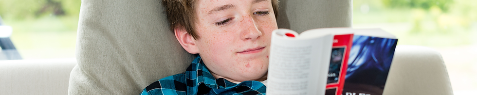 boy reading book.png