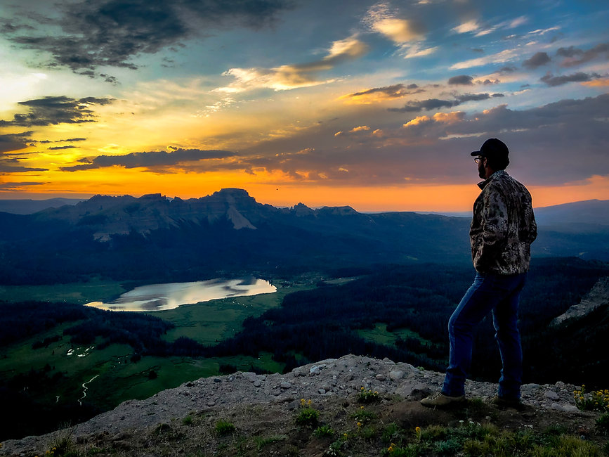 Person watches the sunset at Brooks Lake Lodge, an all-inclusive luxury resort near Yellowstone