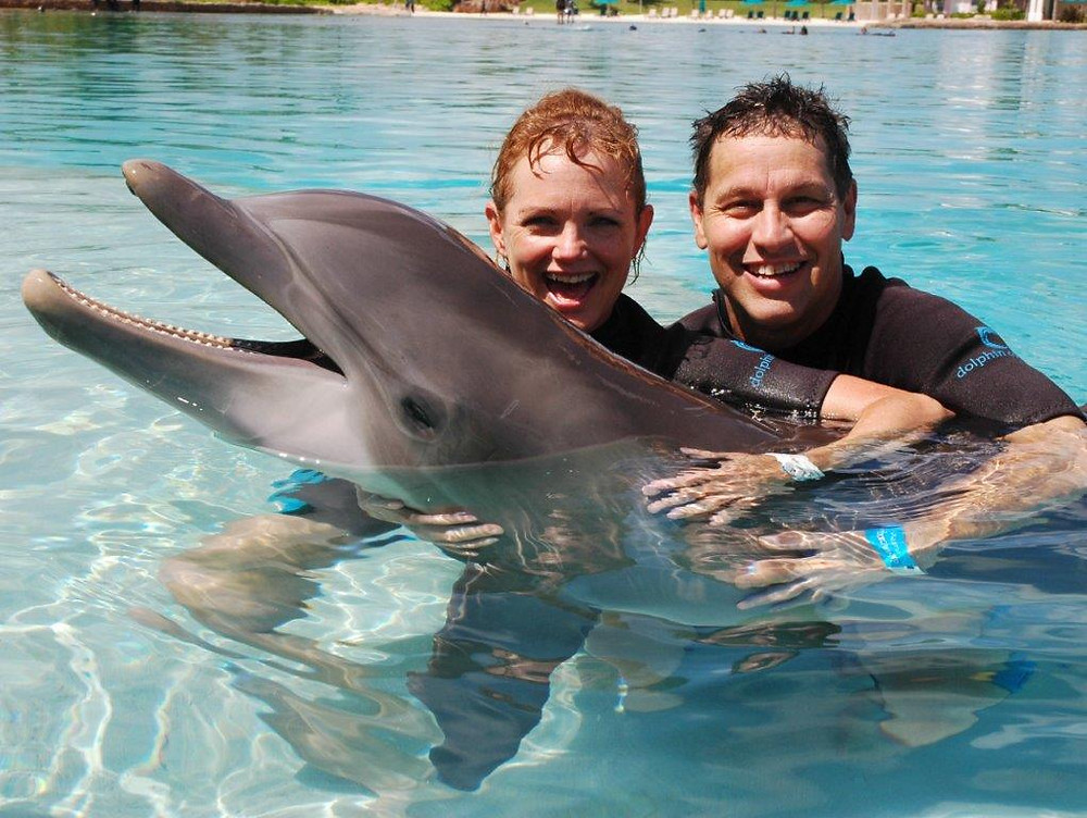 Jodi Bourdin home health consultant with husband and baby dolphin