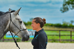 Chloe with her horse in the arena