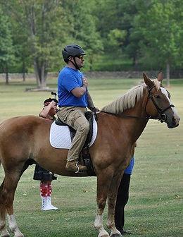 Image: A military verteran on horseback.