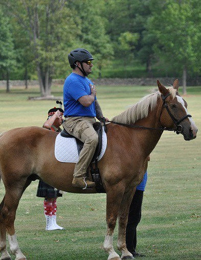 Image: A military veteran riding Pierre.