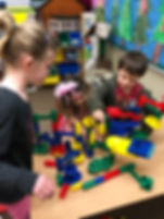 oakview preschool students playing marble track