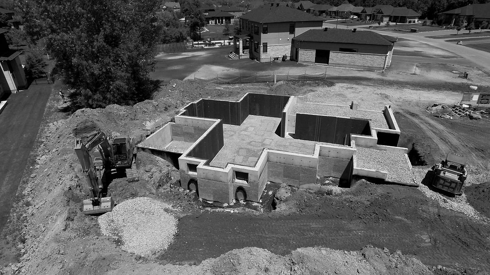 Photo of a home foundation being built.