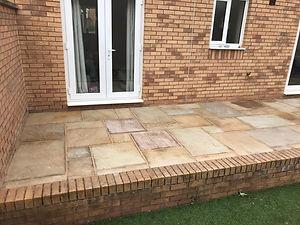 lovely brick border for new patio.jpeg
