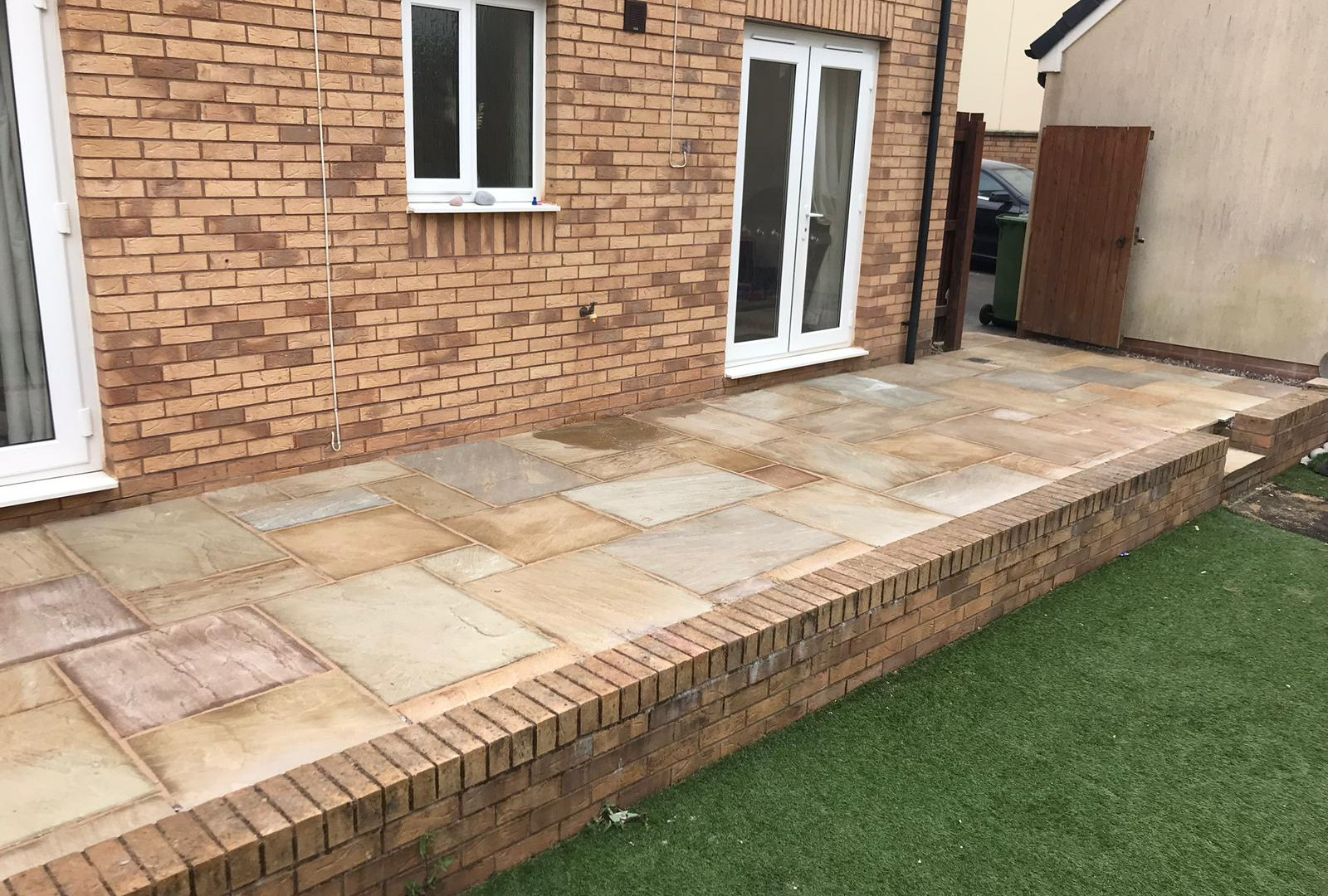 PATIO WITH EDGING BRICK AND STEPS