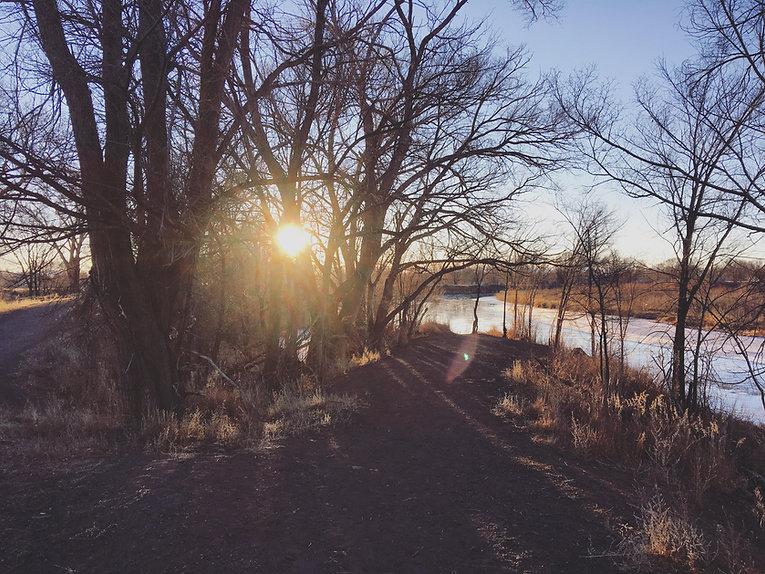 Walking path along the Rio Grande River in Alamosa, Colorado at sunrise.