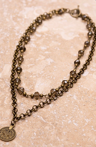 Burnished gold 2 strand short necklace w/ coin pendant.