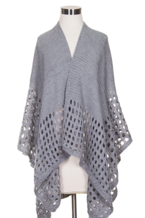 Gray cape w/ cutouts along bottom