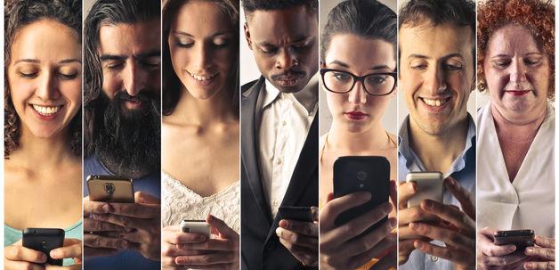 People sending sms with their phones.jpg