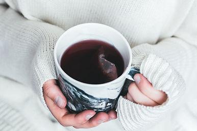 Cup of herbal tea in hands