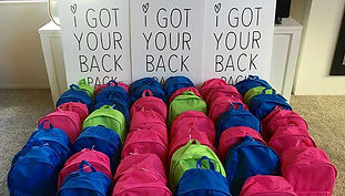 Rows of colourful backpacks