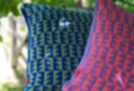 Knitted cushions by shepherdess designer maker Katie Allen of Loopy Ewes