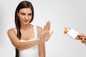 Healthy Young Woman Refusing To Take Cig