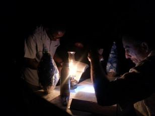 Bible study by lantern