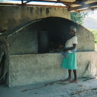 Baking bread in bread oven.jpg