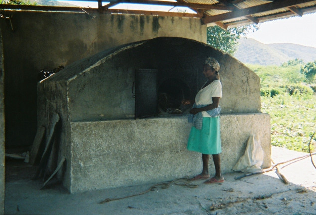Baking bread in bread oven.jpg