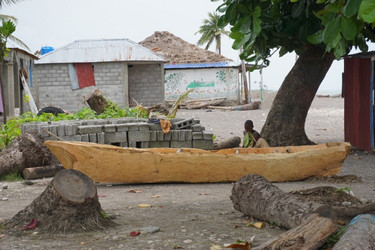 A boat carved from a tree to go fishing with, Haiti.