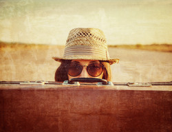 Hipster with suitcase, vintage image